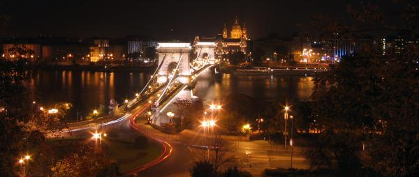 Chain bridge and city at night